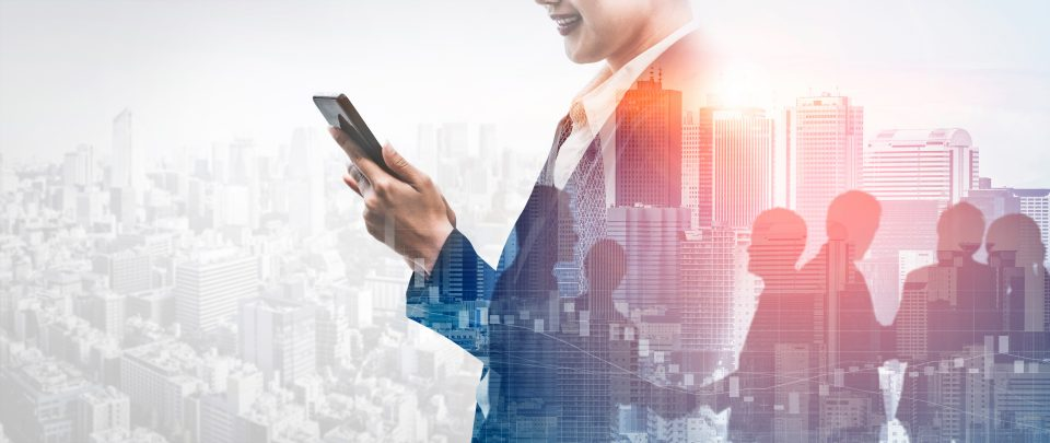 Double Exposure Image of Business Communication Network Technology Concept - Business people using smartphone or mobile phone device on modern cityscape background.