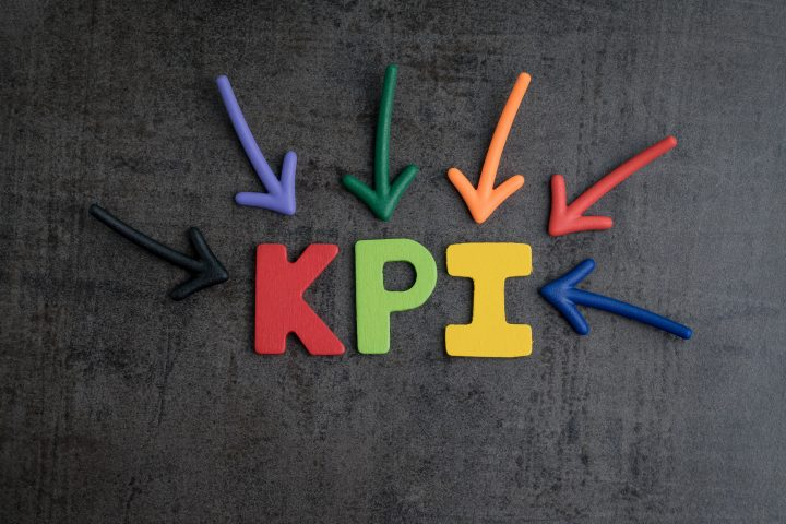KPI, Key Point Indicator business target and goal management concept by multiple arrow pointing to colorful alphabet at the center
